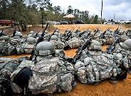 Csatatéri felszerelések tárolásához/továbbításához